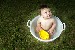Baby having bath outdoors Royalty Free Stock Photography