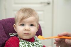 Baby having dinner Royalty Free Stock Photo