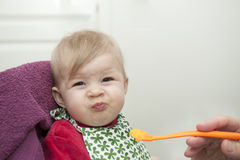 Baby having dinner Royalty Free Stock Photo
