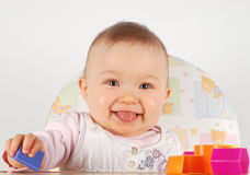 Baby having fun Stock Image