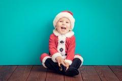 Baby having fun at Christmas time Stock Image