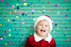 Baby having fun at Christmas time Royalty Free Stock Photography