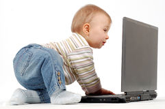 Baby having fun with laptop Stock Photos