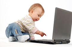 Baby having fun with laptop Stock Image
