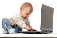 Baby having fun with laptop royalty free stock photo