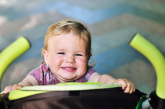 Baby  having fun in the stroller Stock Photography