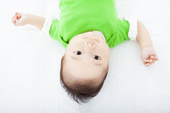Baby having laughing and lying  on the towel Stock Photography