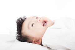 Baby having laughing and lying  on the towel Stock Photos