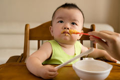 Baby having meal Stock Photos