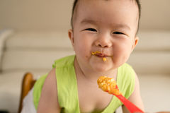 Baby having meal Stock Images