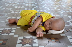 Baby having a nap at the pagoda Royalty Free Stock Photography