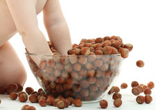 Baby and hazelnuts Royalty Free Stock Photography