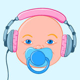 Baby head with earphones Stock Photography