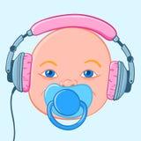 Baby head with earphones Stock Photography