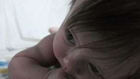 Baby Head Lifting Closeup. A sweet baby in an extreme closeup being super adorable stock video