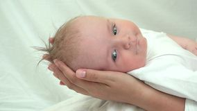 Baby head on mother hands, helpless newborn look, parent protection stock video
