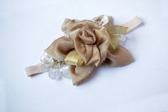 Baby headband, flower made of fabric and lace, beads Stock Photography