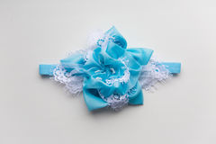 Baby headband, flower made of fabric and lace, beads Stock Image