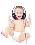 Baby with headphone. Smiling baby with headphone over white background Stock Images