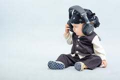 Baby with headphone Stock Image