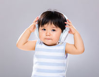 Baby with headphone. With gray background Royalty Free Stock Image