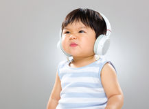 Baby with headphone Royalty Free Stock Images