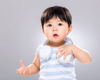 Baby with headphone on shoulder Royalty Free Stock Photo