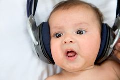 Baby with headphones Royalty Free Stock Photos
