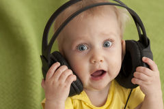 Baby and headphones stock photo