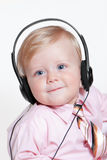 Baby with headphones Stock Images