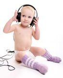 Baby with headphones Stock Photos