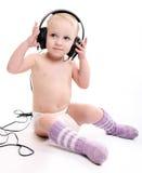 Baby with headphones Stock Photos