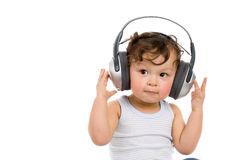 Baby with headphones. Royalty Free Stock Photos