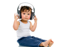 Baby with headphones. Royalty Free Stock Photography