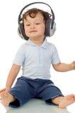 Baby with headphones. Stock Photo