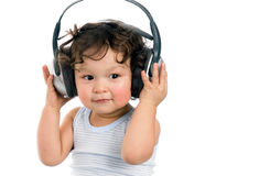 Baby with headphones. Royalty Free Stock Image