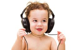 Baby with headphones. Happy baby with headphones on white background Royalty Free Stock Images