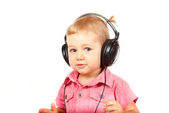 Baby with headphones Royalty Free Stock Photography