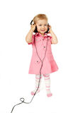 Baby with headphones Royalty Free Stock Image