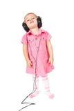 Baby with headphones Stock Photo