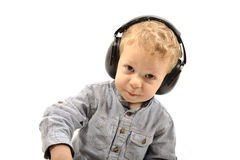 Baby with headphones Stock Photography