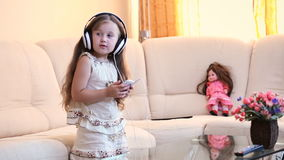 Baby with headphones stock video