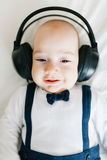 Baby with headphones Stock Image