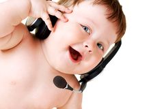 Baby with headset Stock Photos
