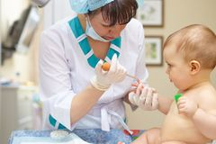 Baby healthcare and treatment. Medical research. Blood tests. Stock Images
