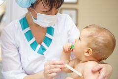 Baby healthcare and treatment. Medical symptoms. Temperature mea Stock Image