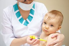 Baby healthcare and treatment. Medical symptoms. Temperature measurement Stock Image