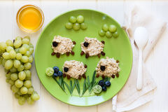 Baby Healthy Breakfast: Oatmeal Sheeps Decorated Berries Royalty Free Stock Image