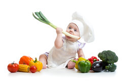 Baby with healthy food vegetables royalty free stock photos