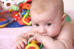 Baby and heap of toys. Portrait of 4months baby with colorful toys Royalty Free Stock Photography